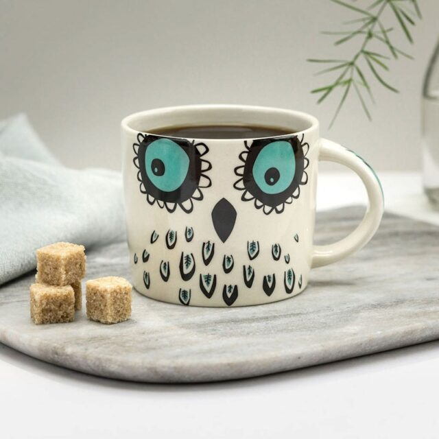 owl mug with sugar lumps on board