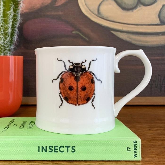 ladybug mug on a book