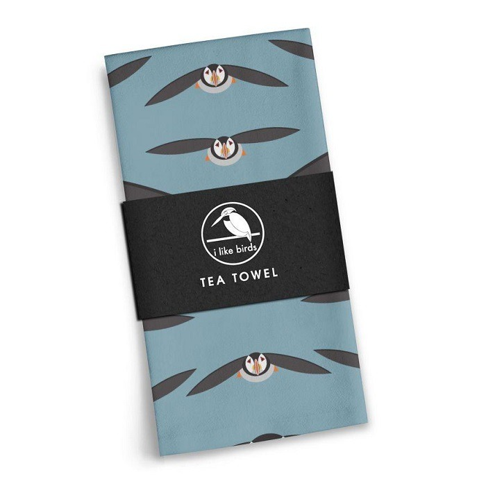 stylised puffins with wings outstretched against air force blue background
