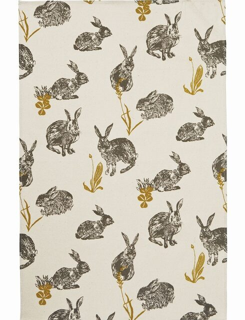 block print rabbit tea towel with animals in black against a cream background