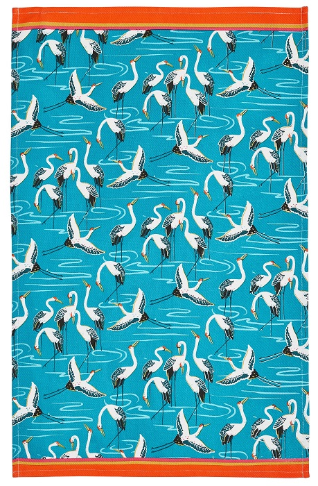 cranes tea towel showing black and white birds against a turquoise background