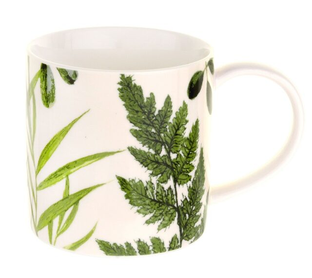 RHS Foliage mug with green leaves against a cream background