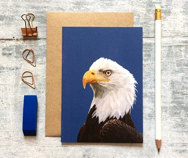 greetings card showing head of an eagle plus a pencil and eraser