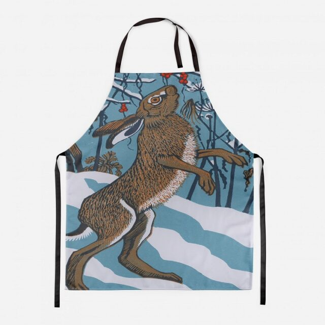 bryony hare apron showing brown hare eating berries against a snow background