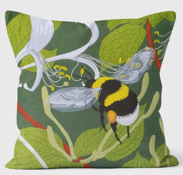 bumble bees cushion showing a bee against a green background