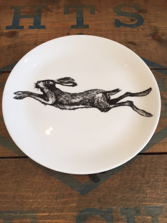 large hare plate with racing hare on white background