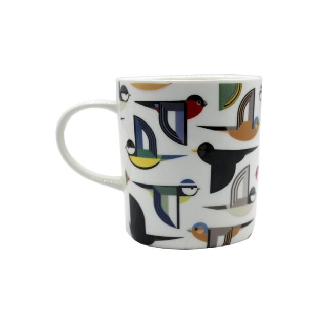 white ceramic mug with stylised birds flying on it