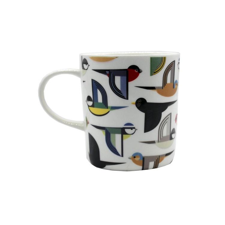 white ceramic mug with stylised birds flying on it