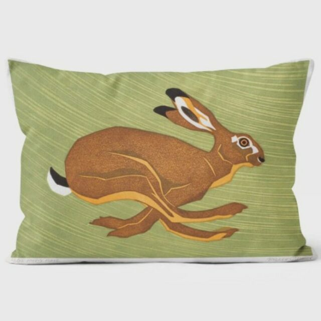 hurry hare in warm browns running facing right against a green background