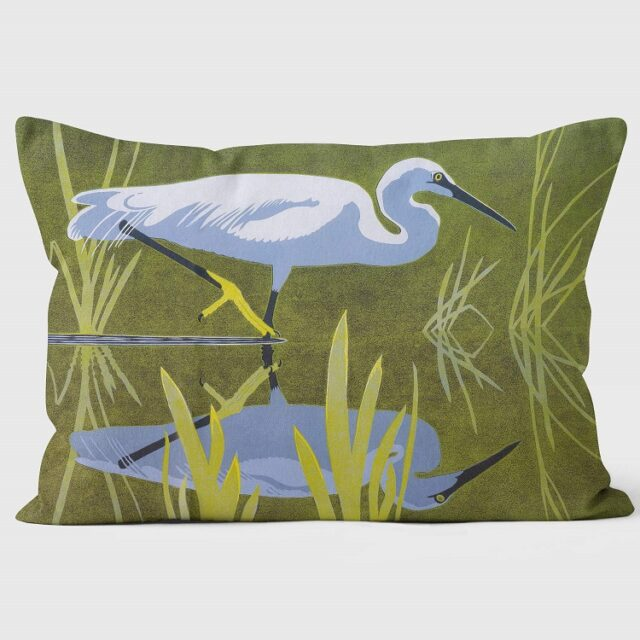 little egret cushion showing the bird stalking facing right in water with green background