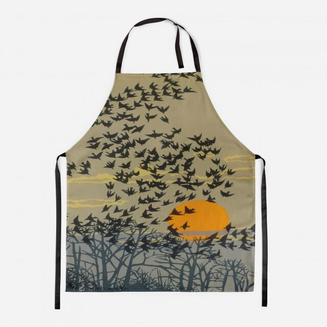 starlings apron showing birds flying against a summer sunset sky