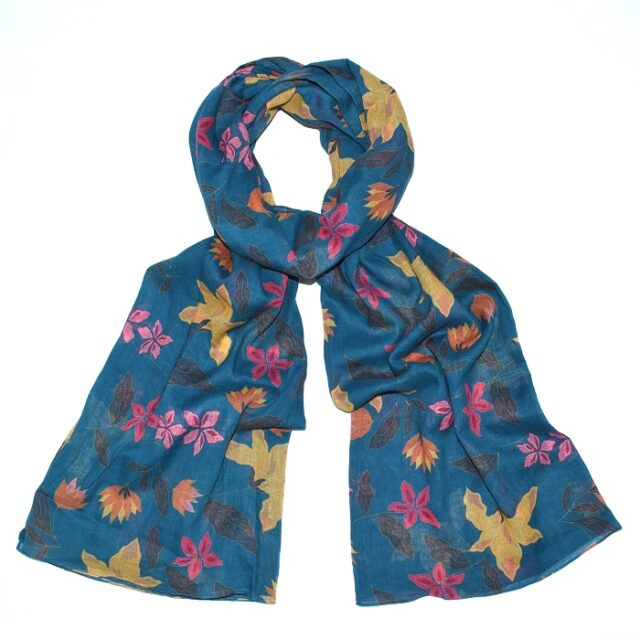 floral scarf with blue background tied loosely in a knot