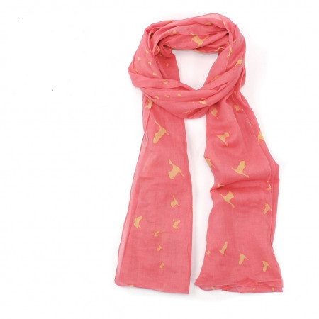 scarf with coral pink background and birds tied loosely in a knot