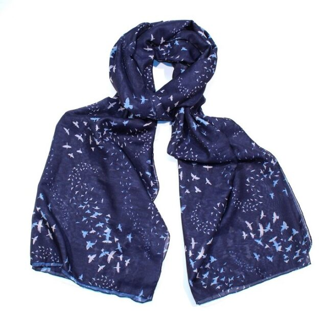 scarf with dark blue background and a flock of birds tied loosely in a knot