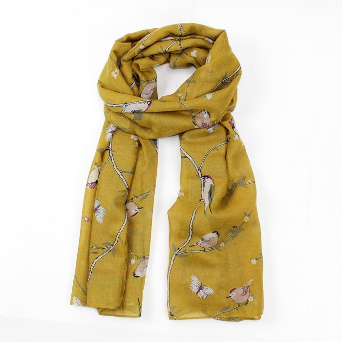 scarf with mustard yellow background and woodpeckers on branches tied loosely in a knot