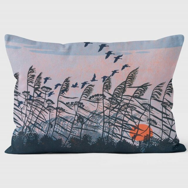 Robert Gillmor - Sunset Flight Cushion by We Love Cushionsshowing birds and grasses silhouetted against an evening sky