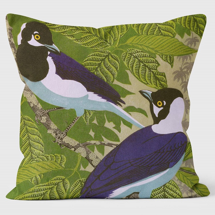 two jays cushion shows the birds against green leaves and branches