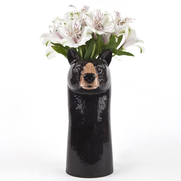 black bear vase by quail ceramics shows tall black vase with bear's face and flowers on top