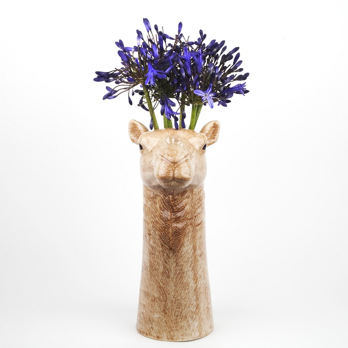 camel vase by quail ceramics shows the warm brown camel vase with blue flowers in