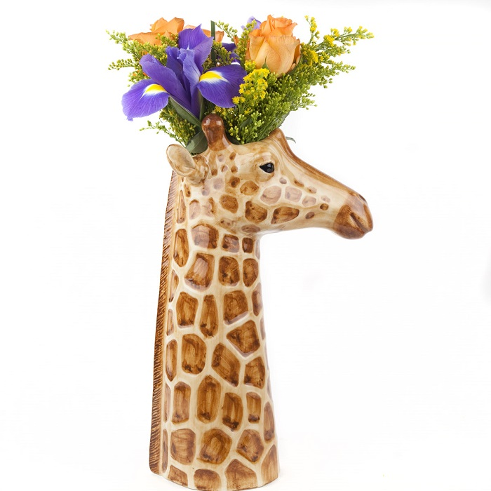 giraffe vase by quail ceramics shows side view of tall vase with giraffe's head in profile and blue and orange flowers