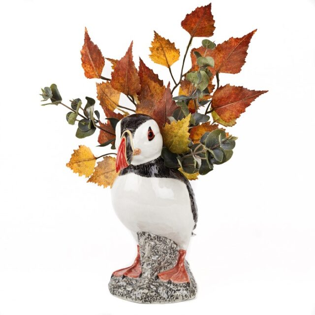 puffin vase by quail ceramics shows the bird with red feet and colourful beak with autumn leaves in the top