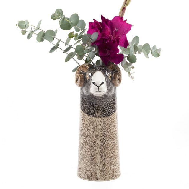 swaledale vase by quail ceramics shows the tall vase with a sheep's head and flowers