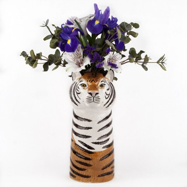 tiger vase by quail ceramics shows black, whist and orange vase with tigers head and flowers