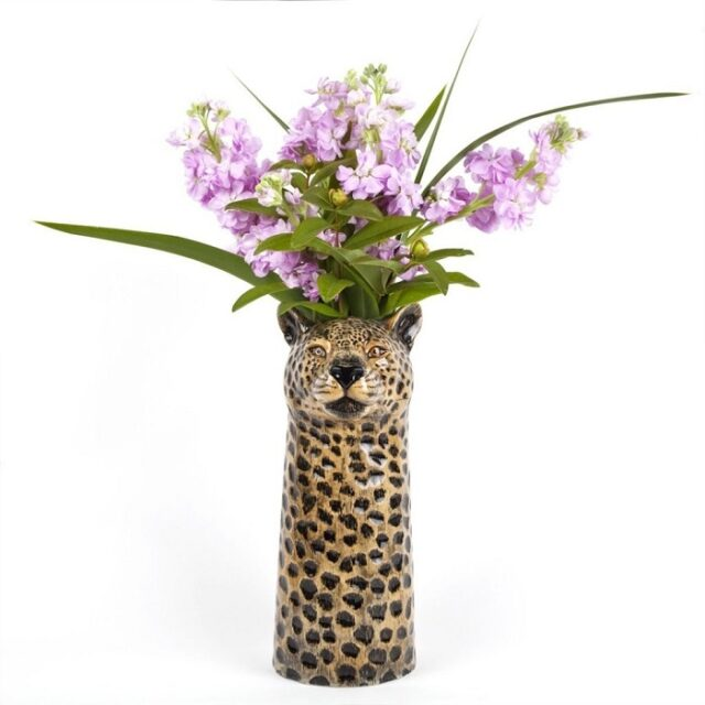 leopard vase by quail ceramics shows the spotty vase with leopard's head and mauve flowers