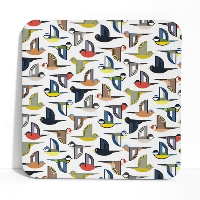 Flock placemats shows stylised birds in a multi coloured repeat pattern